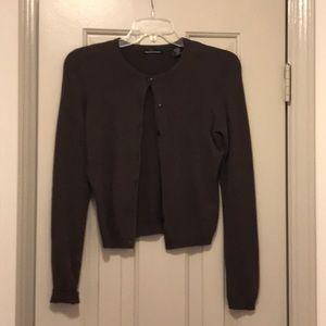 Brown cardigan sweater.